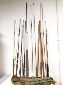Fishing interest: a collection of fishing rods, carrying cases, one marked Scotte and inscribed