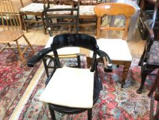 A mixed group of chairs including an ebonised armchair with anthemion relief to seat and a late