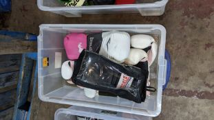5 assorted pairs of boxing gloves including several that appear to be designed for women with pink d