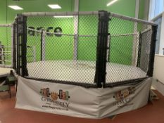 Octagonal fighting cage.