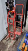 2 off red metal sack trucks, one with conventional foot plate & the other as pictured