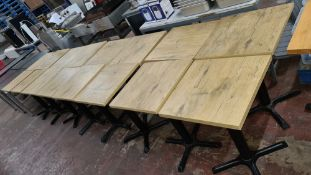 16 off matching café tables with black metal single pedestal bases & wooden tops each 500mm square