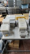 Double row of assorted metal dishes suitable for use in bain maries, refrigerated saladettes, etc