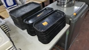 3 stacks of black trays - approximately 65 trays in total