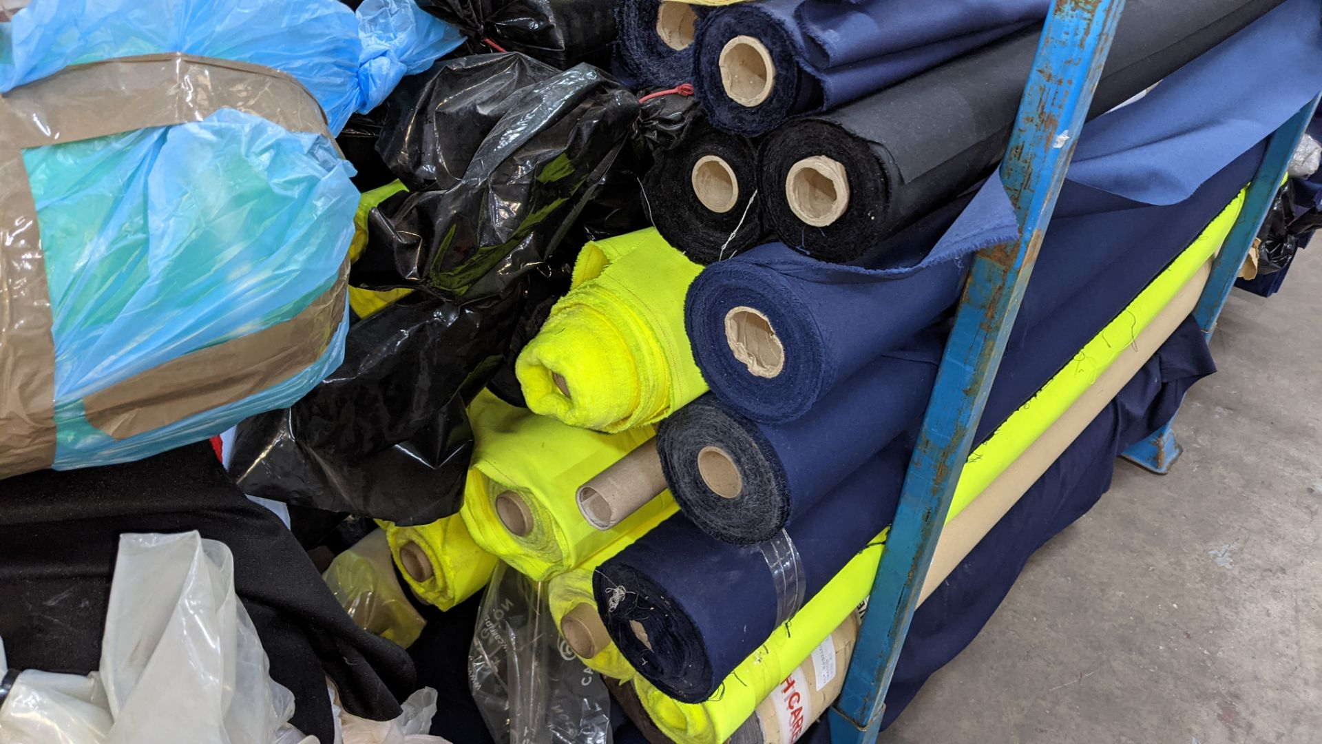 The contents of a large stillage of fabric including quantity of high visibility cloth. Please note - Image 5 of 8