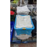 The contents of 4 crates of white clothing, assumed to be for the catering industry. NB crates excl