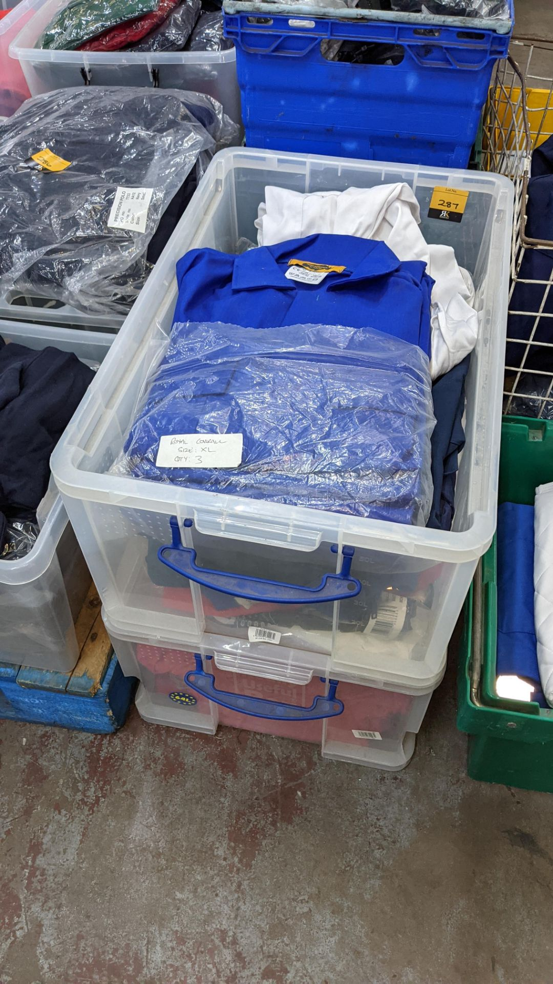 The contents of 2 crates of assorted boiler suits & similar. NB crates excluded