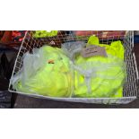 The contents of a cage of off-cuts & unfinished garments, all in yellow hi-vis fabrics. NB cage exc