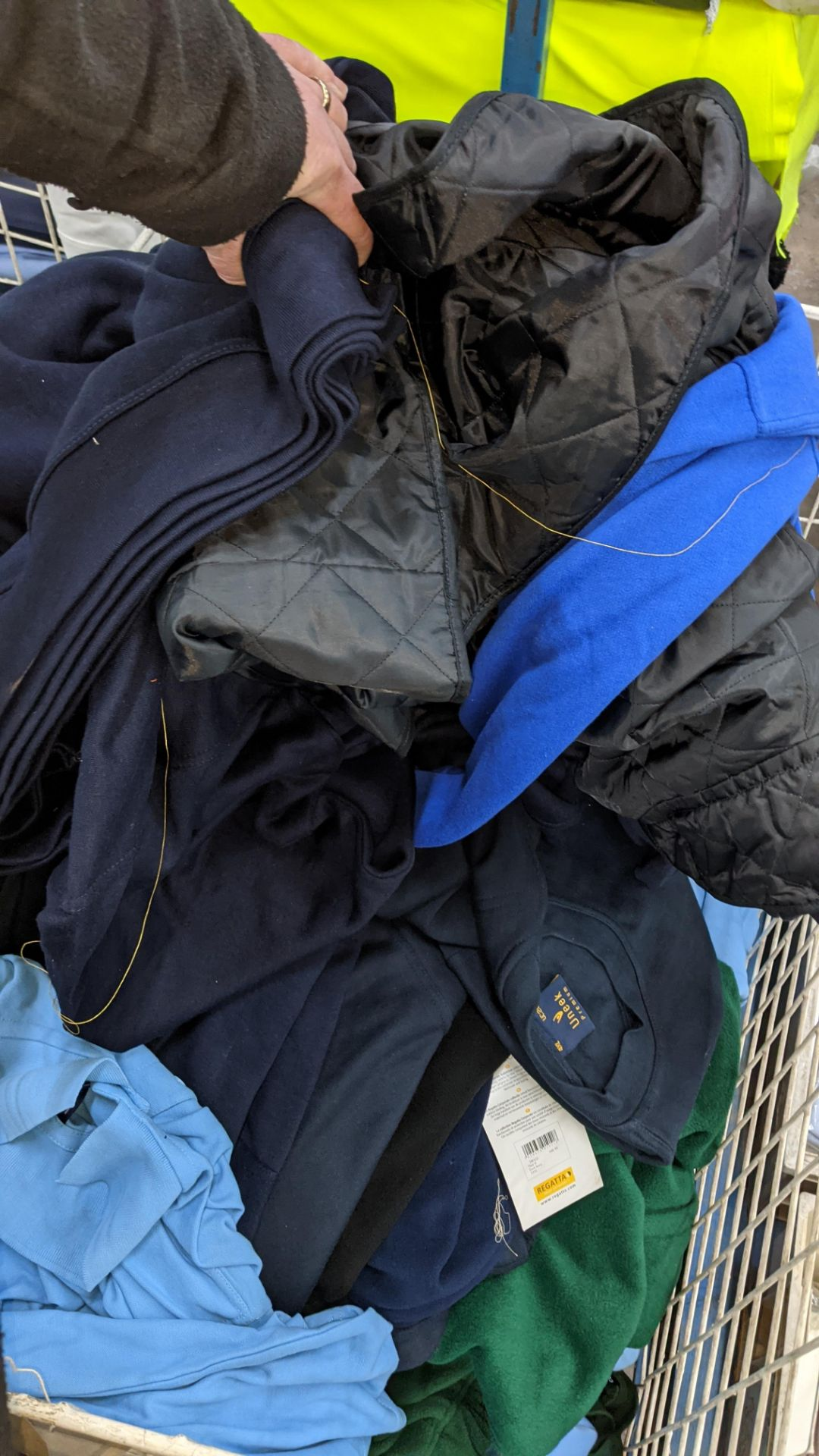 The contents of a cage of assorted adults garments. NB cage excluded - Image 5 of 5