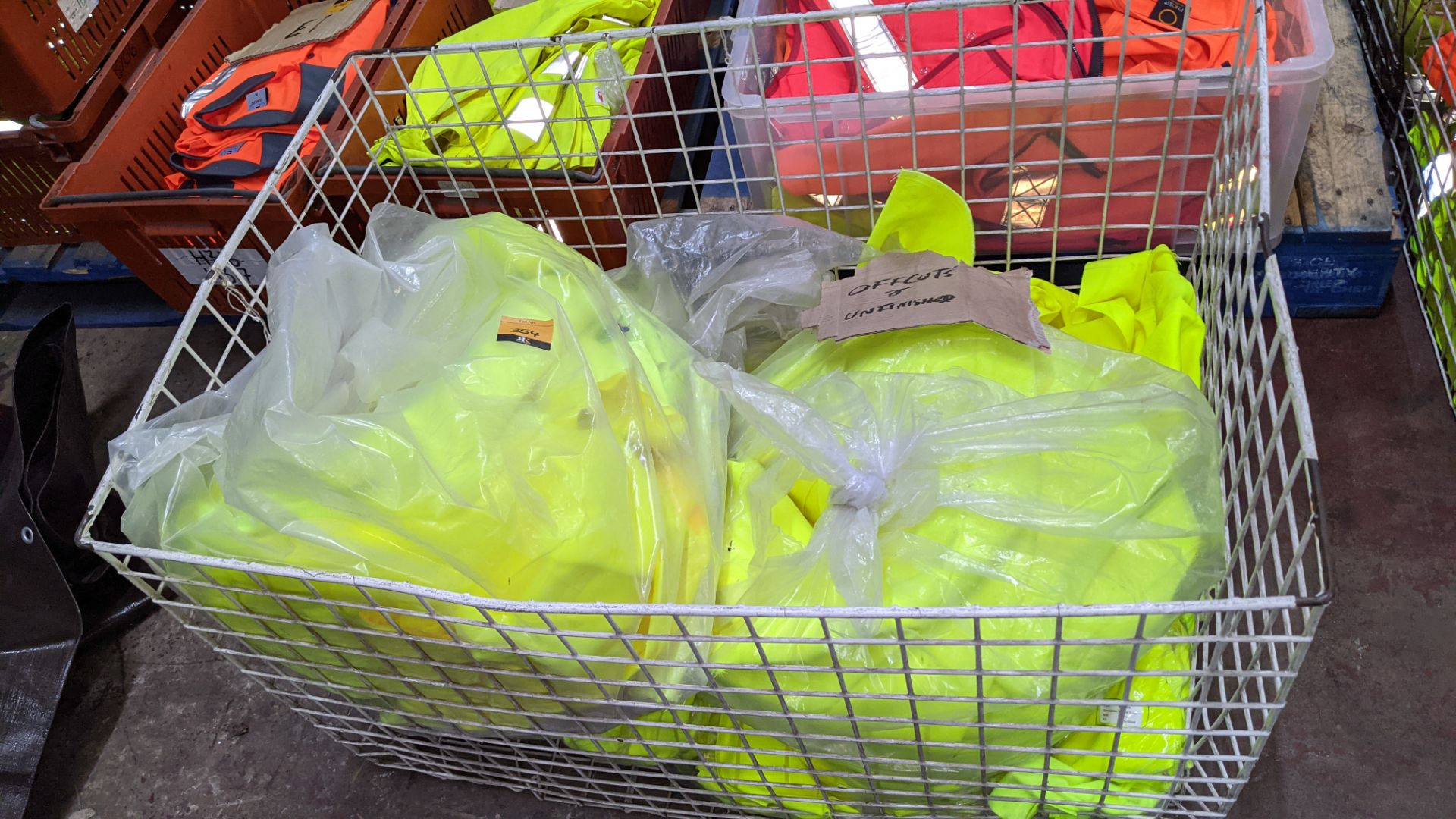 The contents of a cage of off-cuts & unfinished garments, all in yellow hi-vis fabrics. NB cage exc - Image 2 of 4
