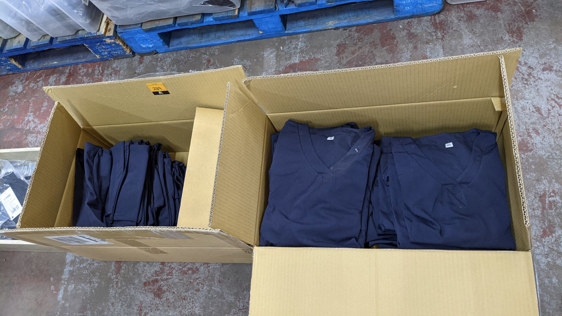 Approx 48 off navy V neck t-shirts - the contents of 2 boxes