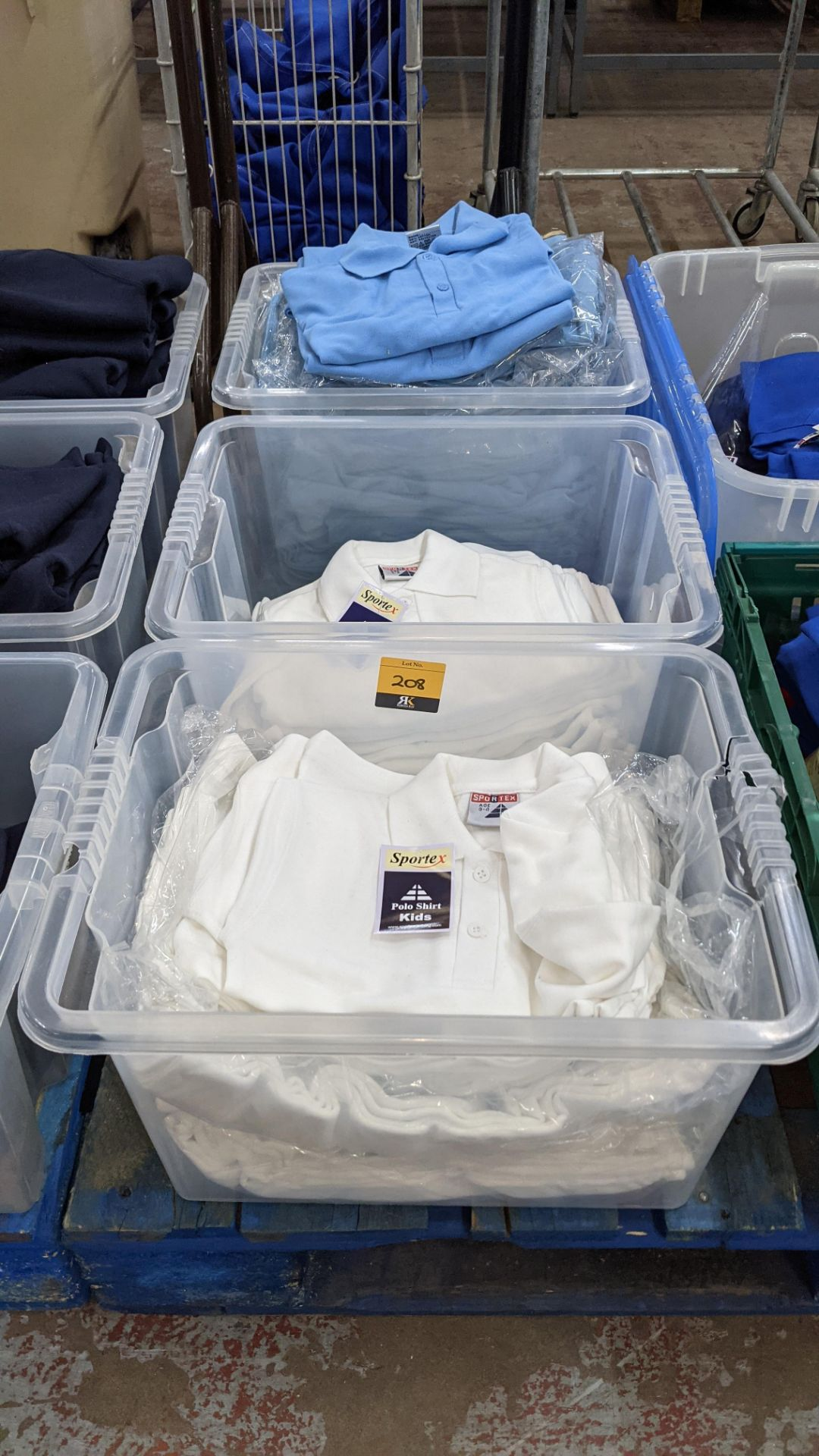 Approx 60 off Sportex children's polo shirts in white & blue - the contents of 3 crates. NB crates