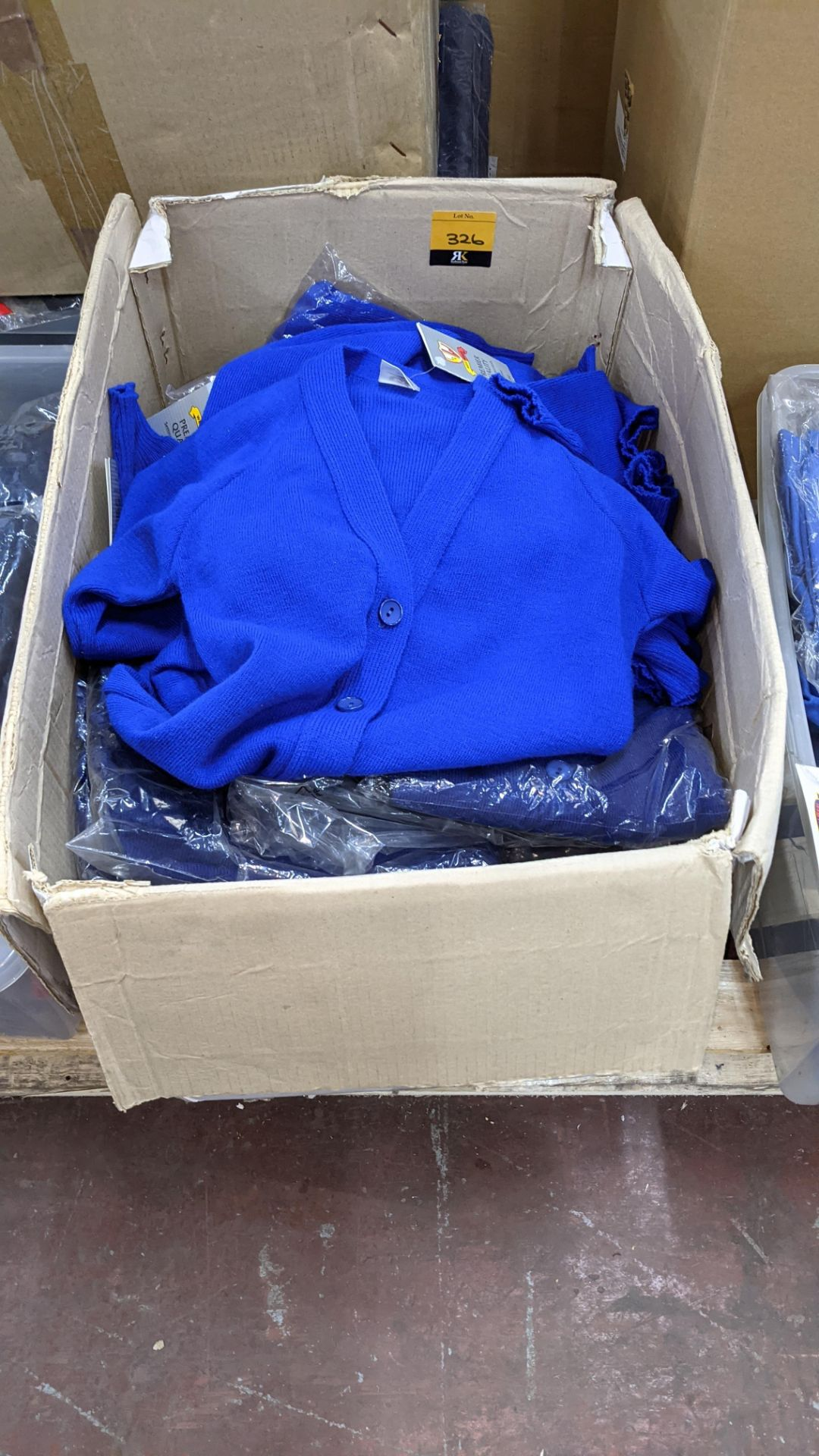 Approx 26 off blue button up children's tops - the contents of 1 large box