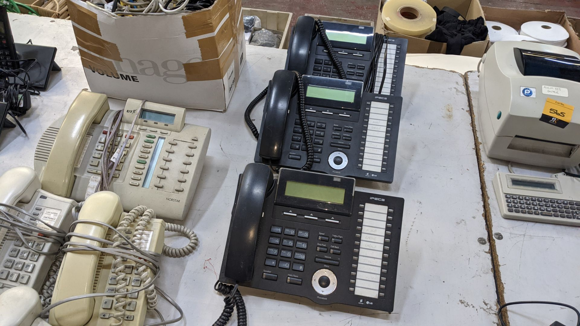 The contents of a table of telephone equipment comprising DECT cordless handsets & office phones - Image 7 of 8
