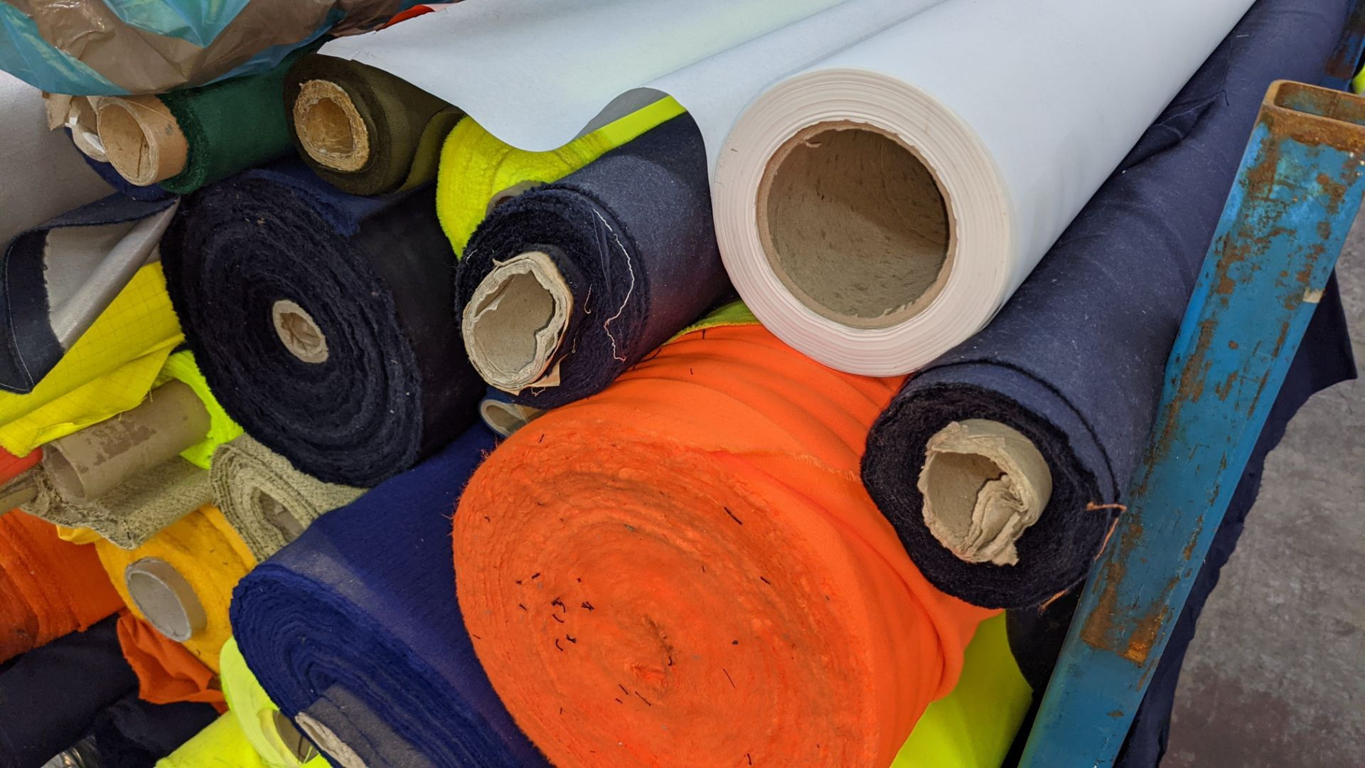 The contents of a large stillage of fabric including quantity of high visibility cloth. Please note - Image 7 of 10