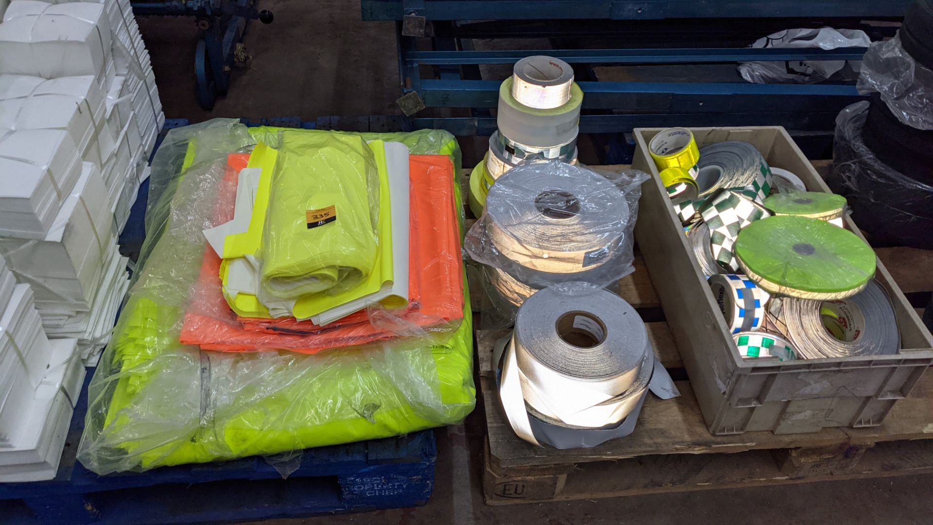 Quantity of hi-vis & reflective fabric & trim comprising 1 stack of fabric, 1 row of reels & the con - Image 2 of 9