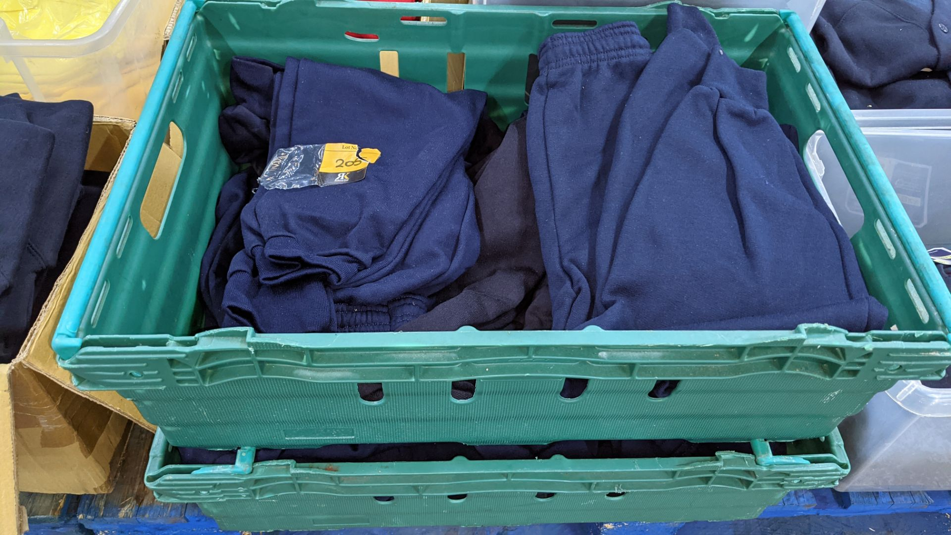 Approx 17 off children's blue tracksuit bottoms in assorted styles - the contents of 2 crates. NB c