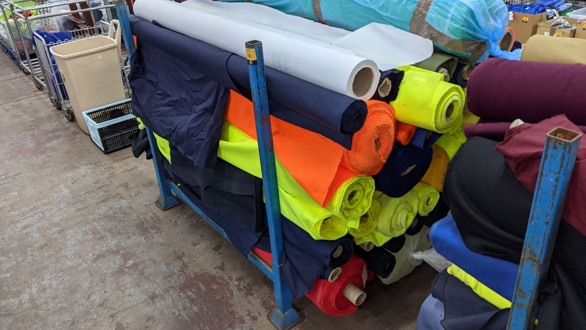 The contents of a large stillage of fabric including quantity of high visibility cloth. Please note - Image 10 of 10