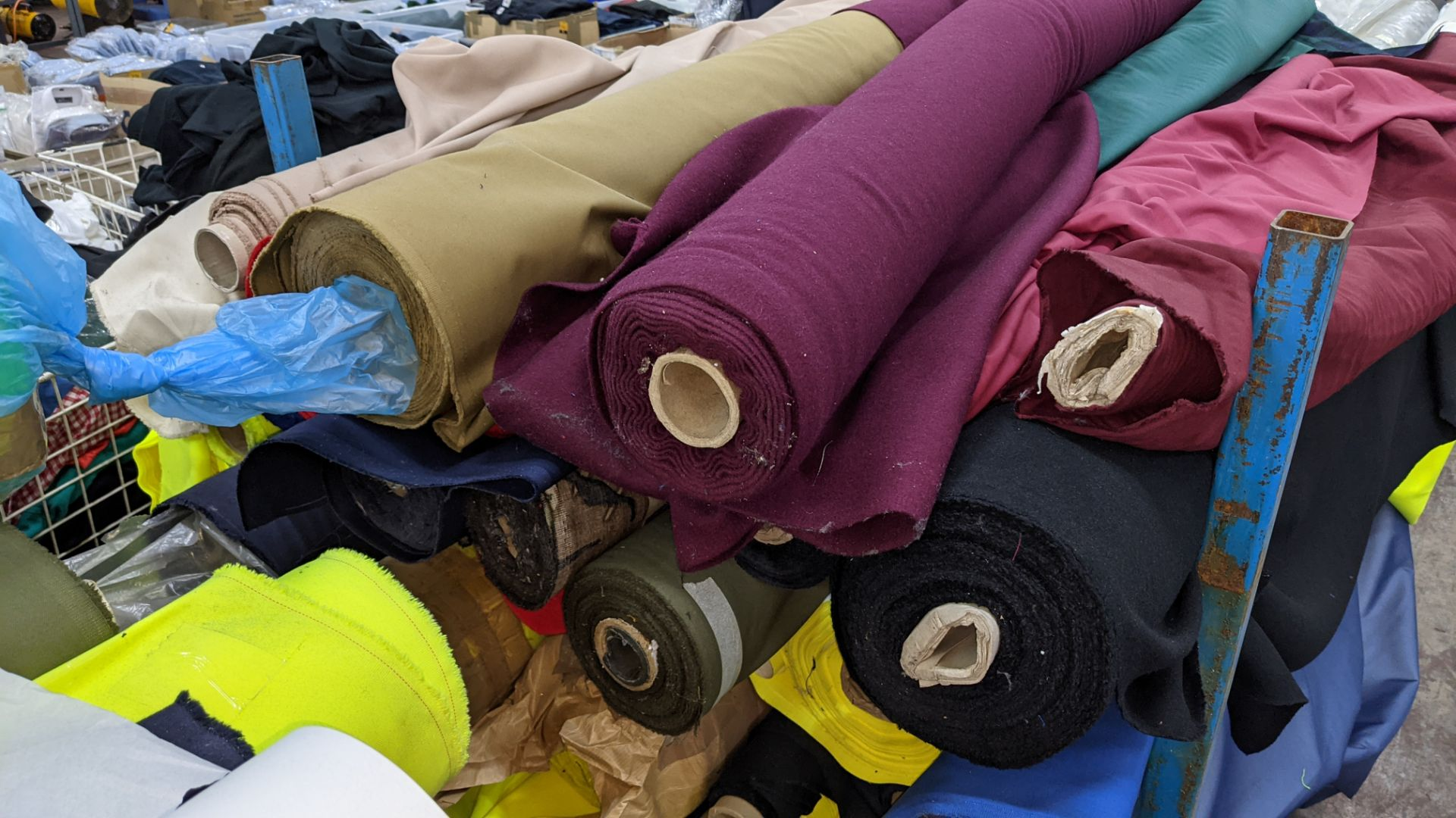 The contents of a large stillage of fabric including quantity of high visibility cloth. Please note - Image 3 of 9