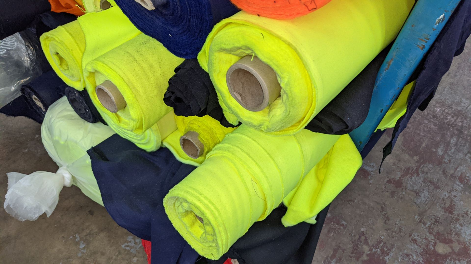 The contents of a large stillage of fabric including quantity of high visibility cloth. Please note - Image 8 of 10