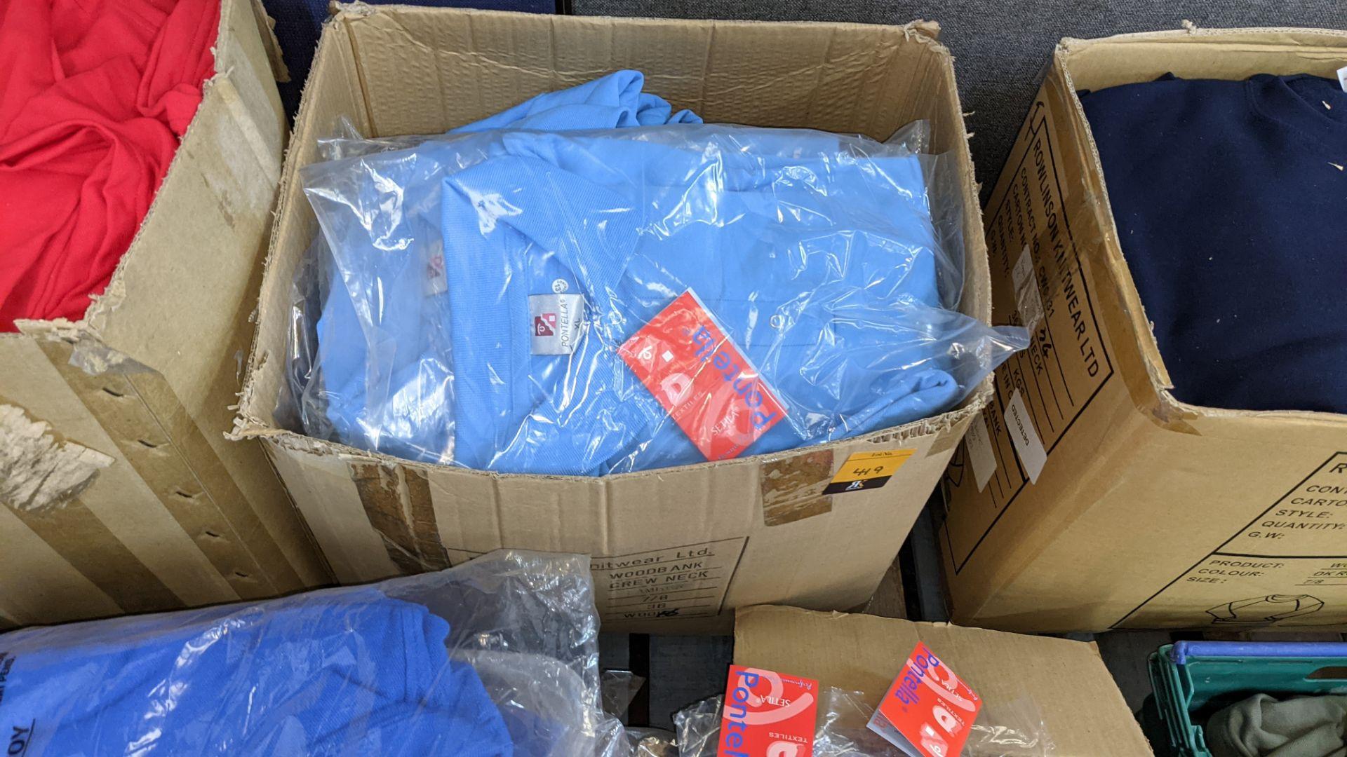 Quantity of pale blue polo shirts