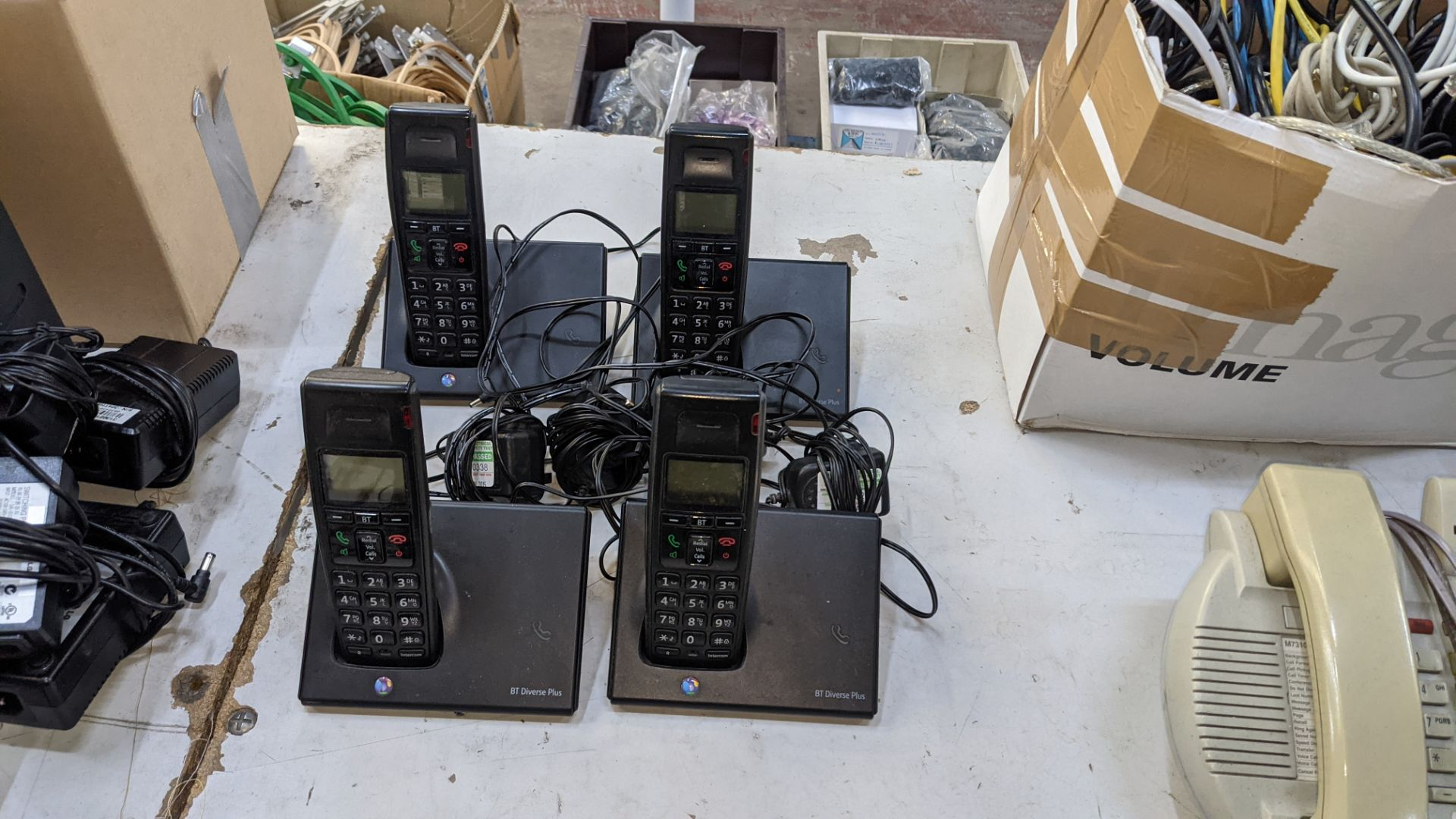 The contents of a table of telephone equipment comprising DECT cordless handsets & office phones - Image 4 of 8