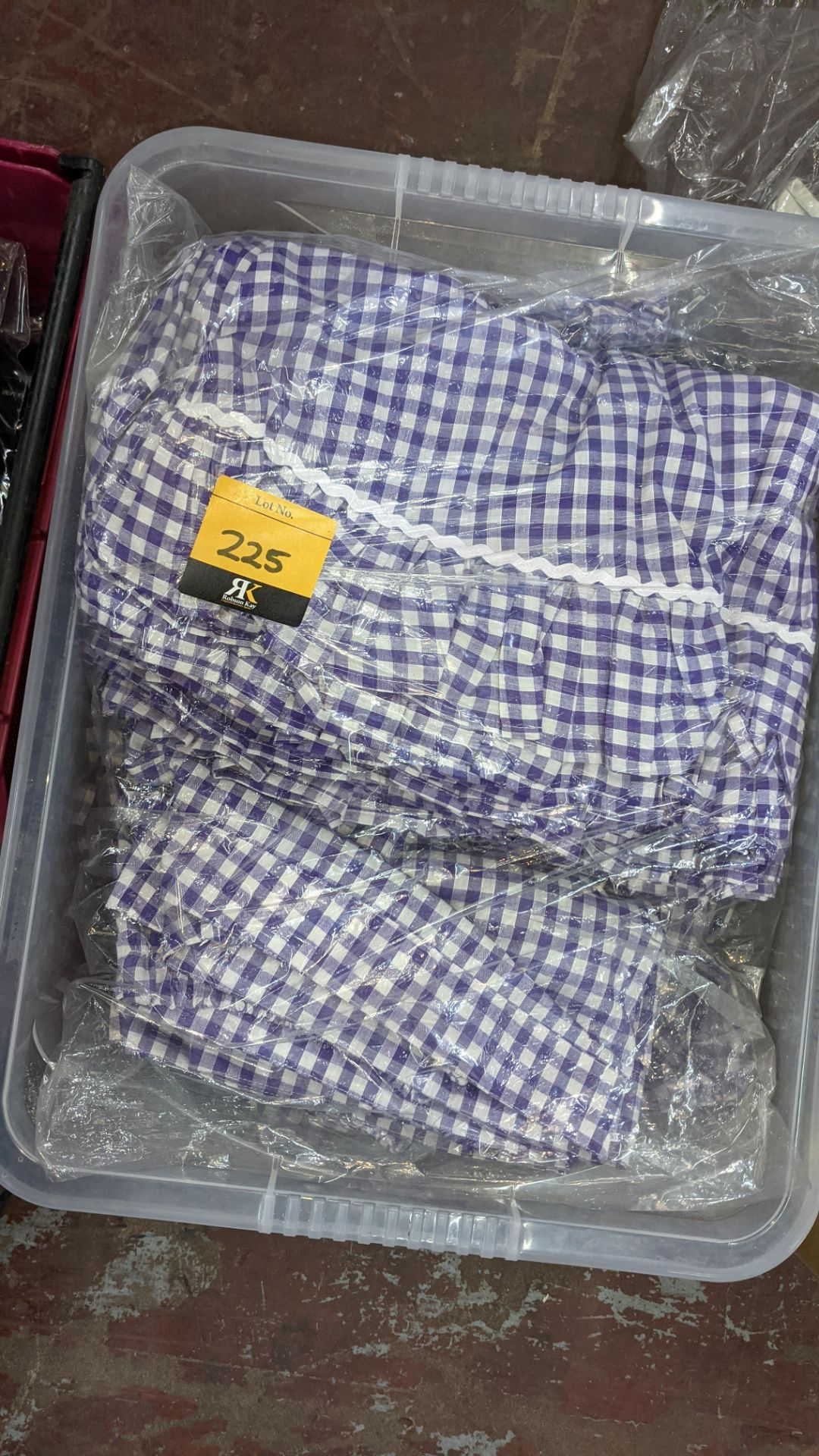 The contents of a crate of children's check skirts. NB crate excluded - Image 3 of 6