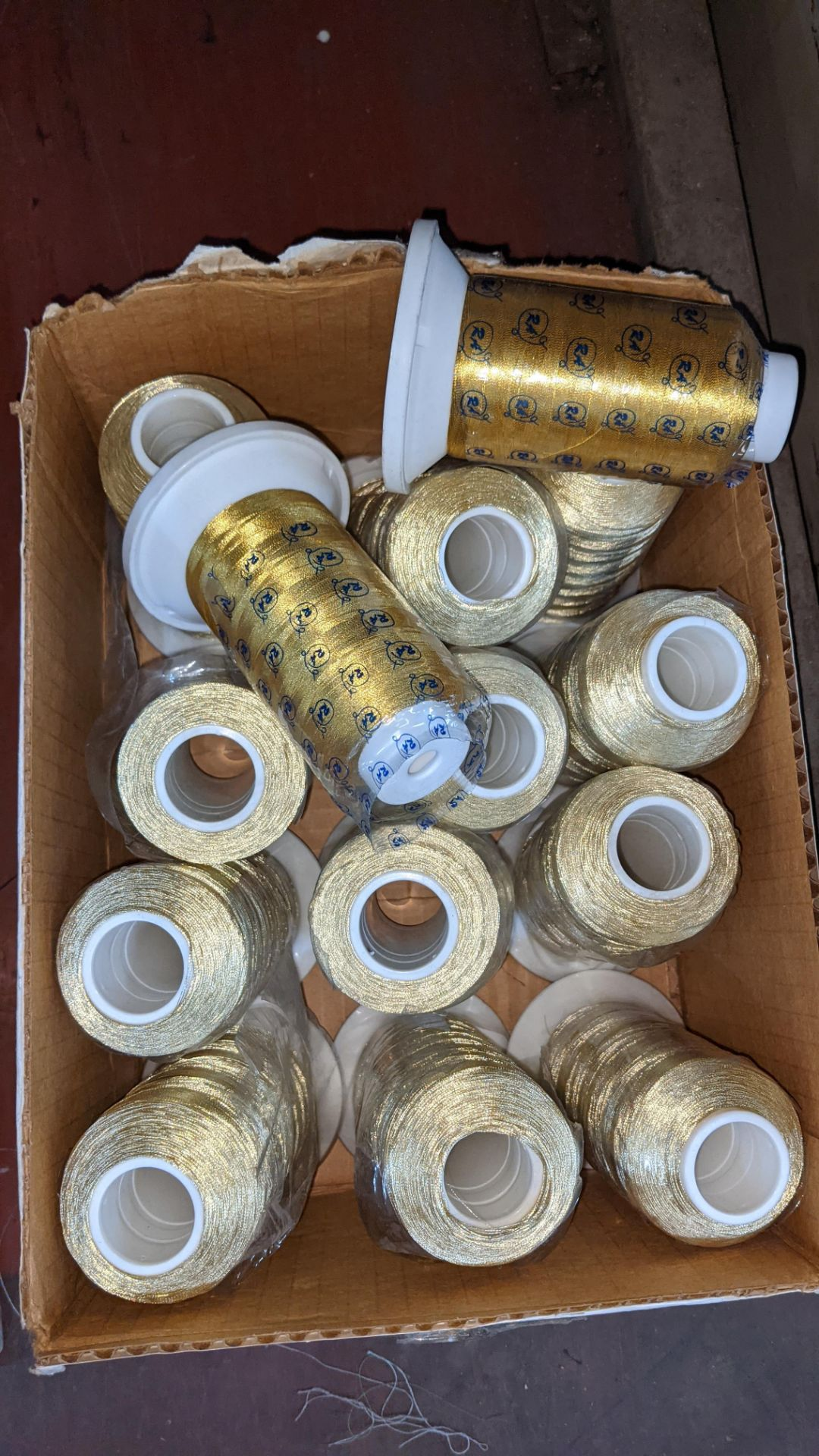 "Box of gold thread, comprising 12 reels of metallic Euro glo & 2 reels of ""Gov't Gold"" - Image 3 of 3"