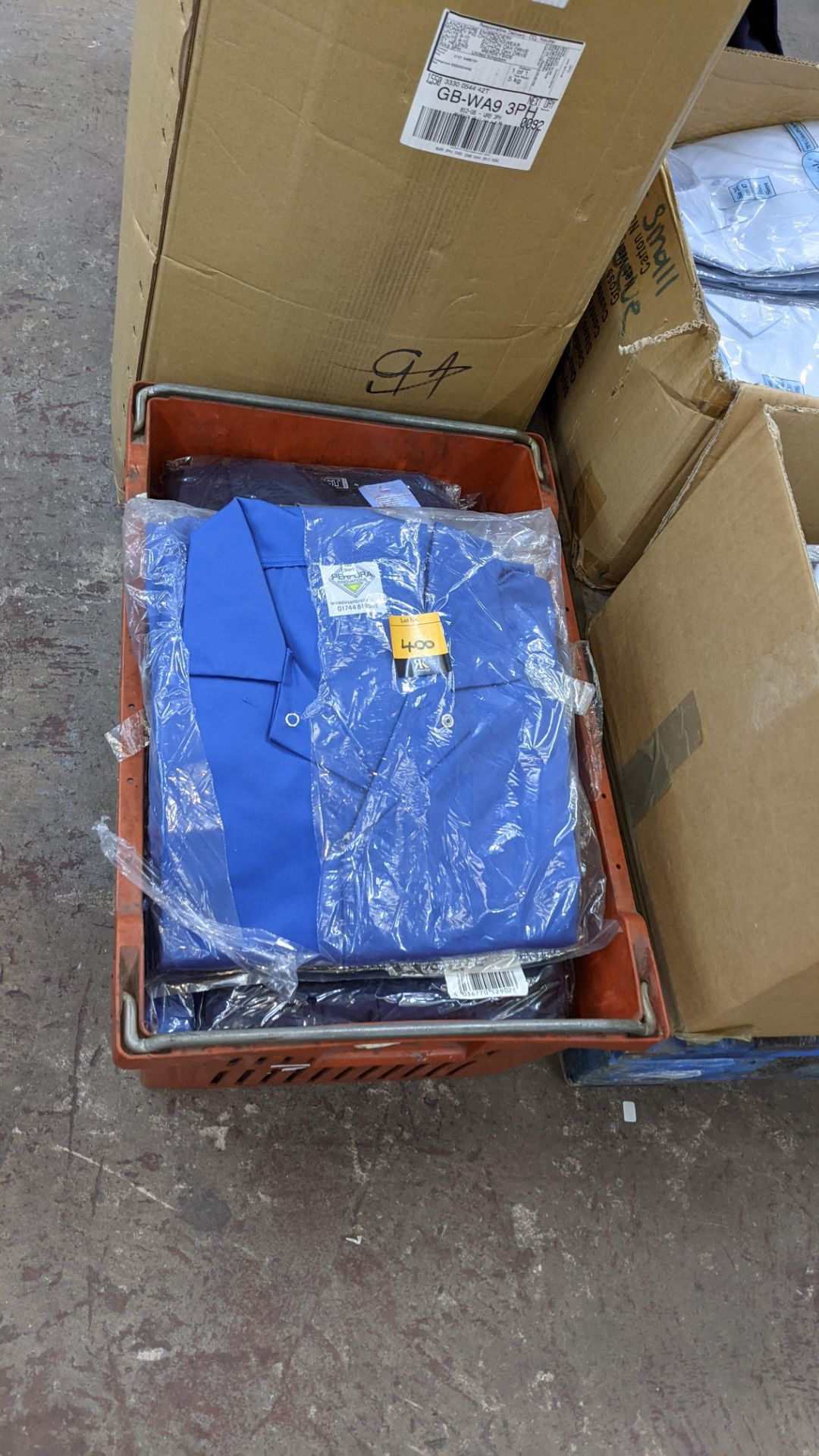 The contents of a crate of work coveralls & similar