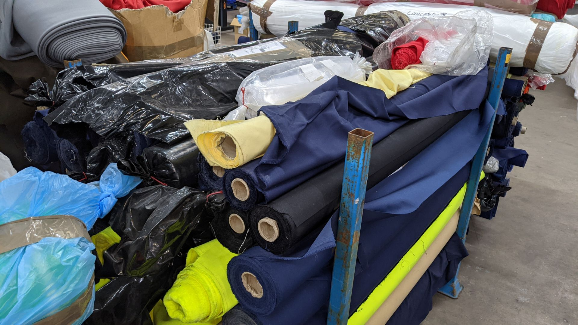 The contents of a large stillage of fabric including quantity of high visibility cloth. Please note - Image 4 of 8