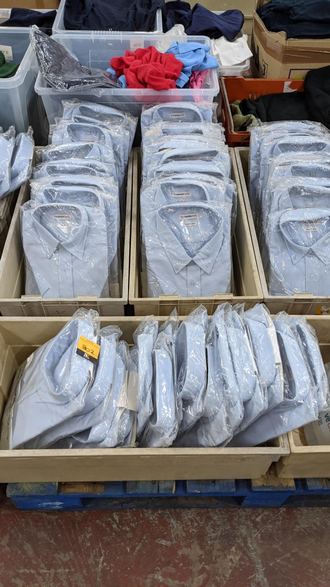 Approx 35 off blue short sleeve shirts with button down collars - the contents of 3 crates. NB cra