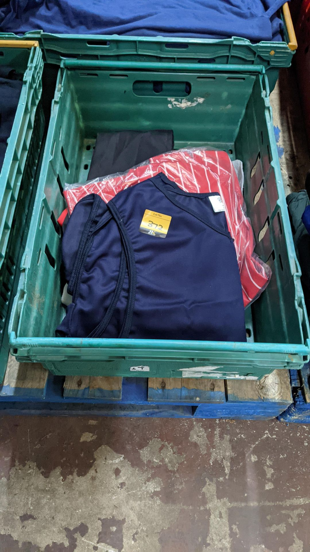 The contents of a crate of assorted aprons & other coveralls
