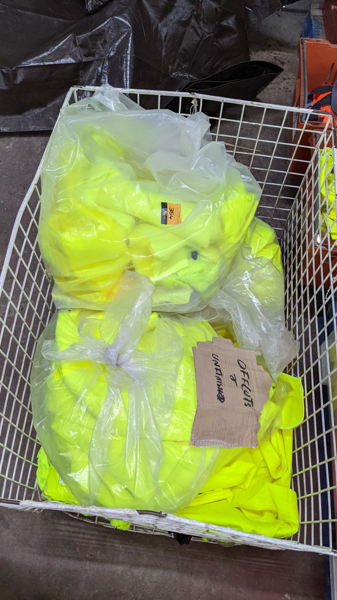 The contents of a cage of off-cuts & unfinished garments, all in yellow hi-vis fabrics. NB cage exc - Image 4 of 4