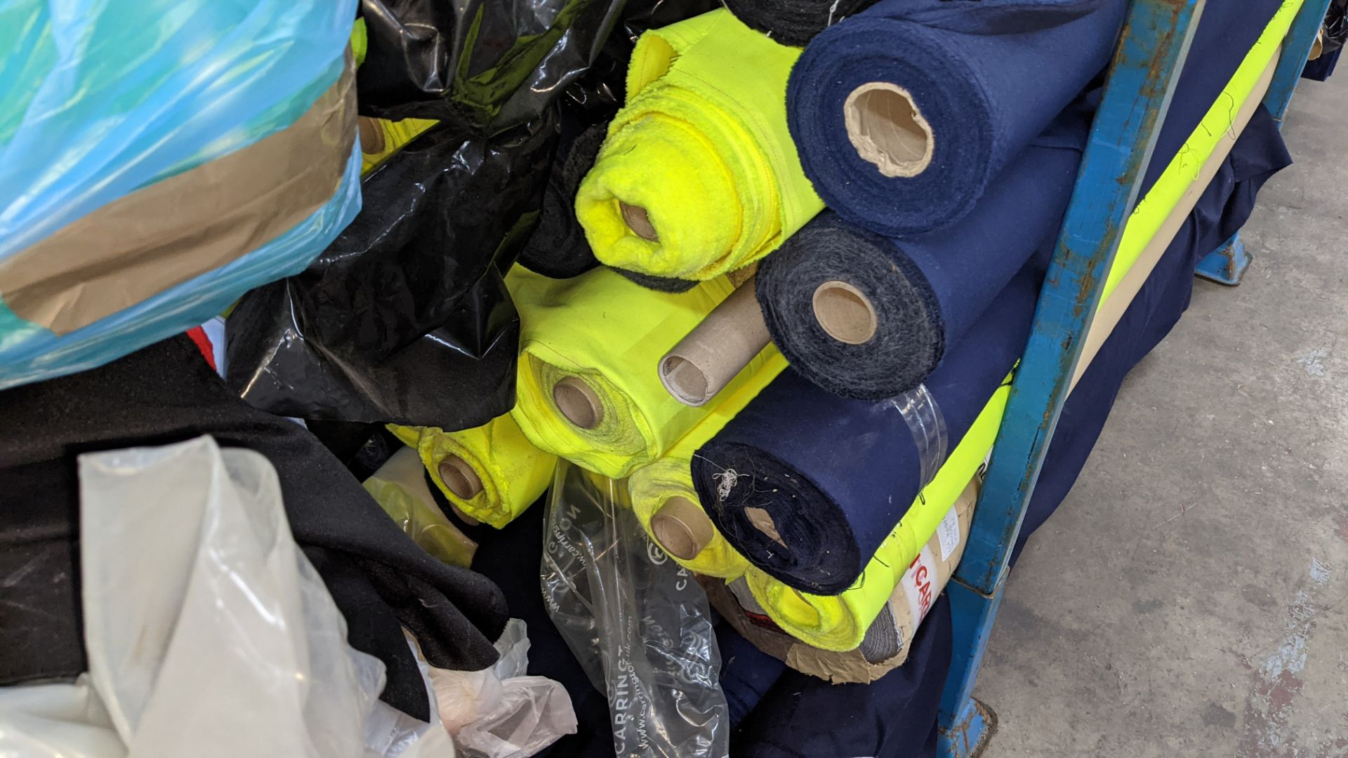 The contents of a large stillage of fabric including quantity of high visibility cloth. Please note - Image 6 of 8