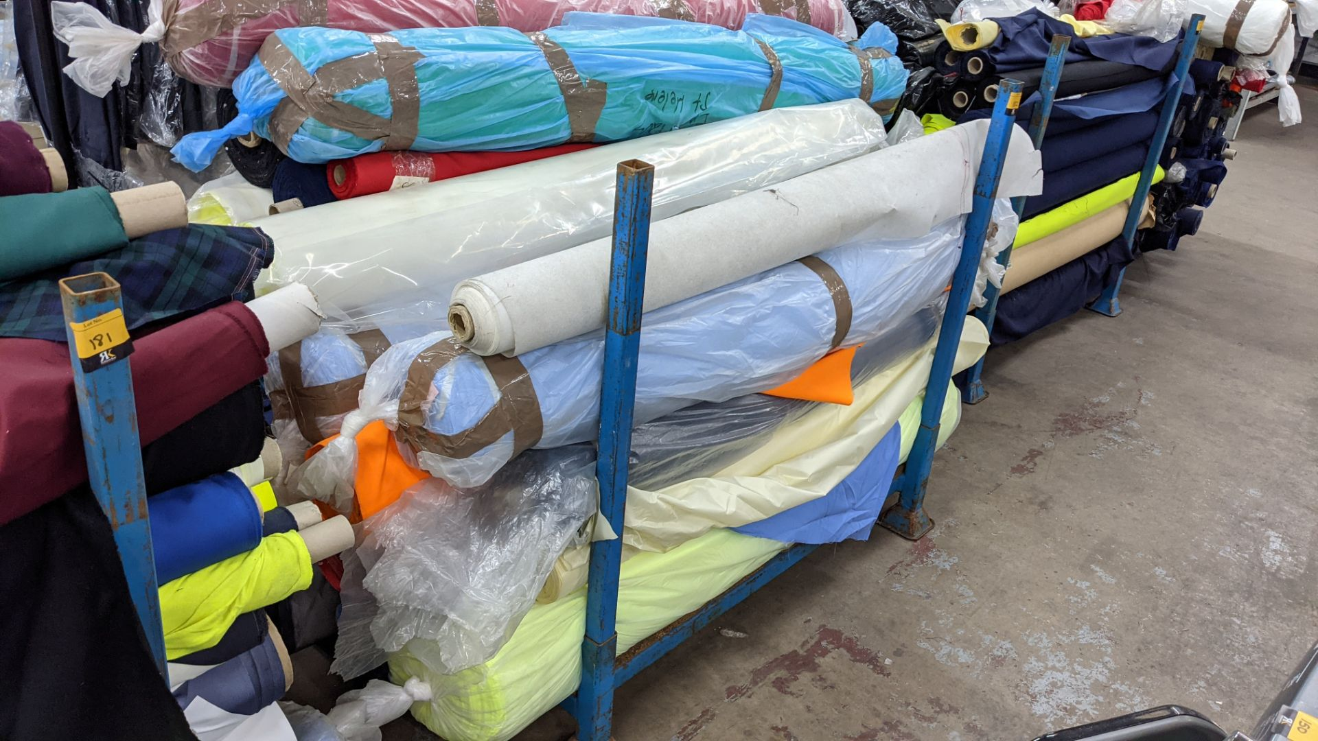 The contents of a large stillage of fabric including quantity of high visibility cloth. Please note - Image 3 of 12