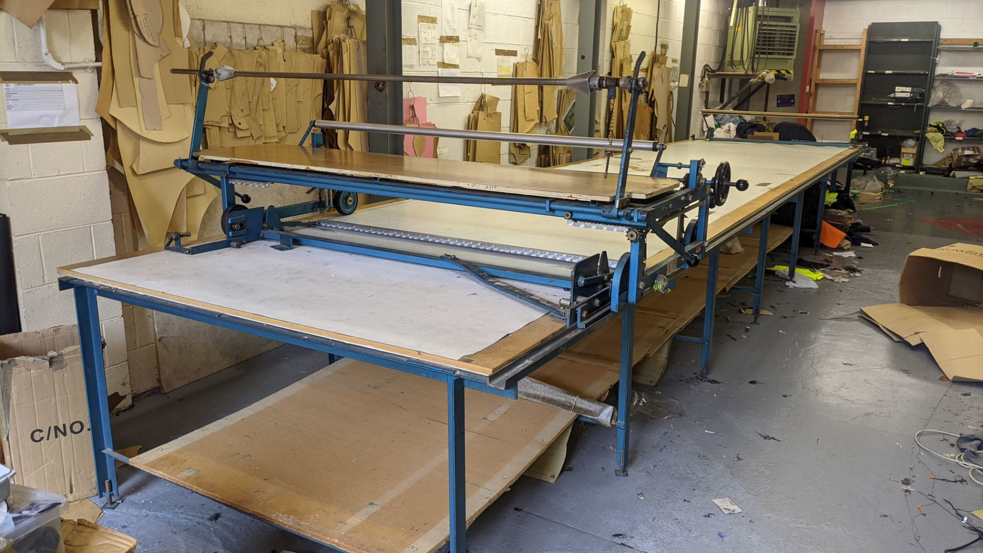 Large cutting table, as shown in 3 stacks. Please note photos taken in situ before the table was de