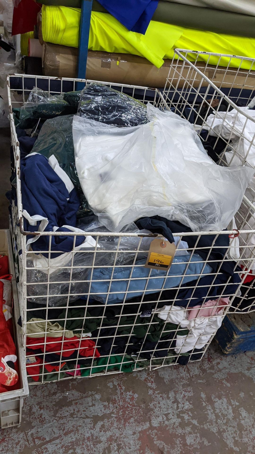 The contents of a cage of assorted adults garments. NB cage excluded - Image 2 of 6