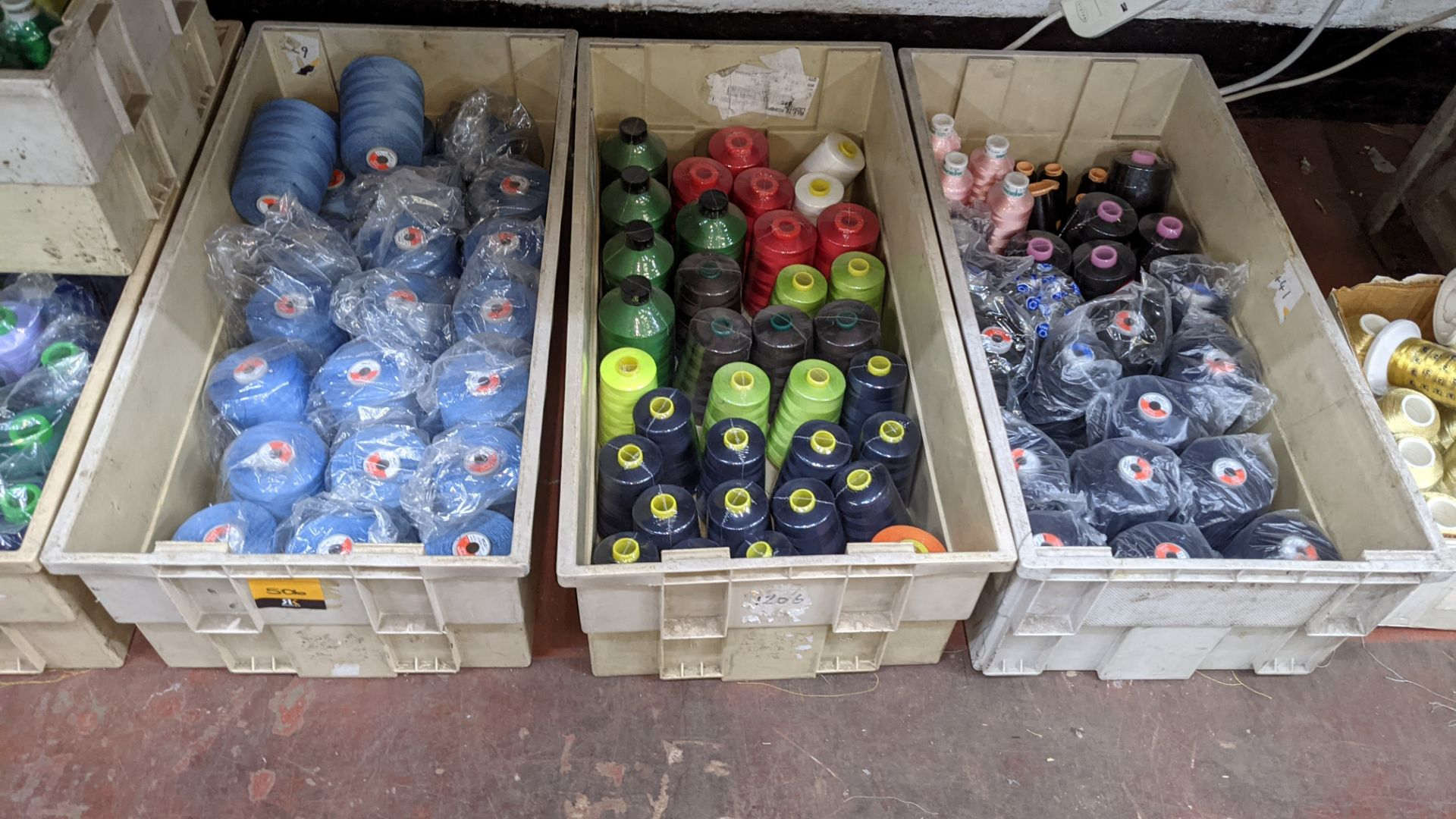 The contents of 3 large crates of thread