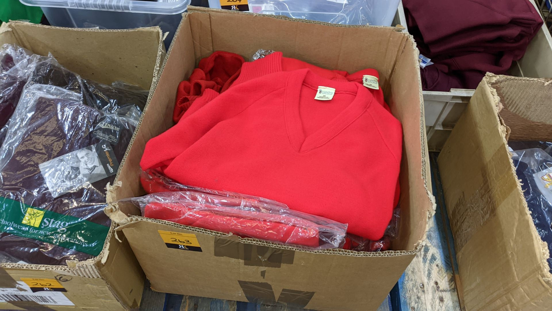 Approx 17 off children's red knitted tops - the contents of 1 box