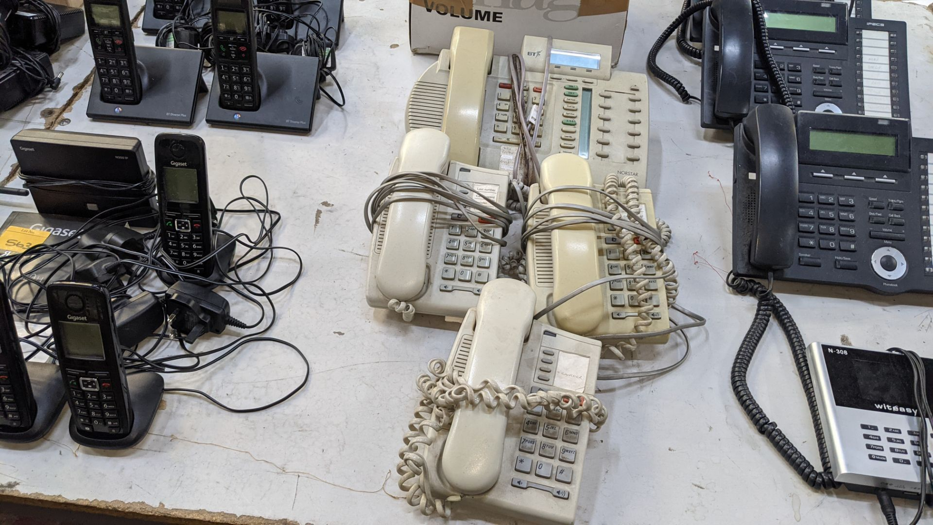 The contents of a table of telephone equipment comprising DECT cordless handsets & office phones - Image 5 of 8