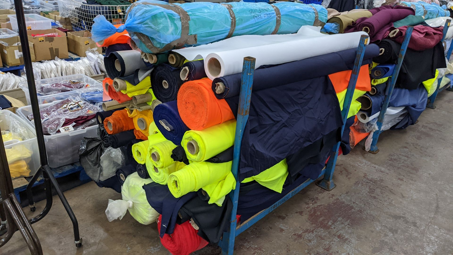 The contents of a large stillage of fabric including quantity of high visibility cloth. Please note - Image 2 of 10