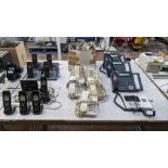 The contents of a table of telephone equipment comprising DECT cordless handsets & office phones