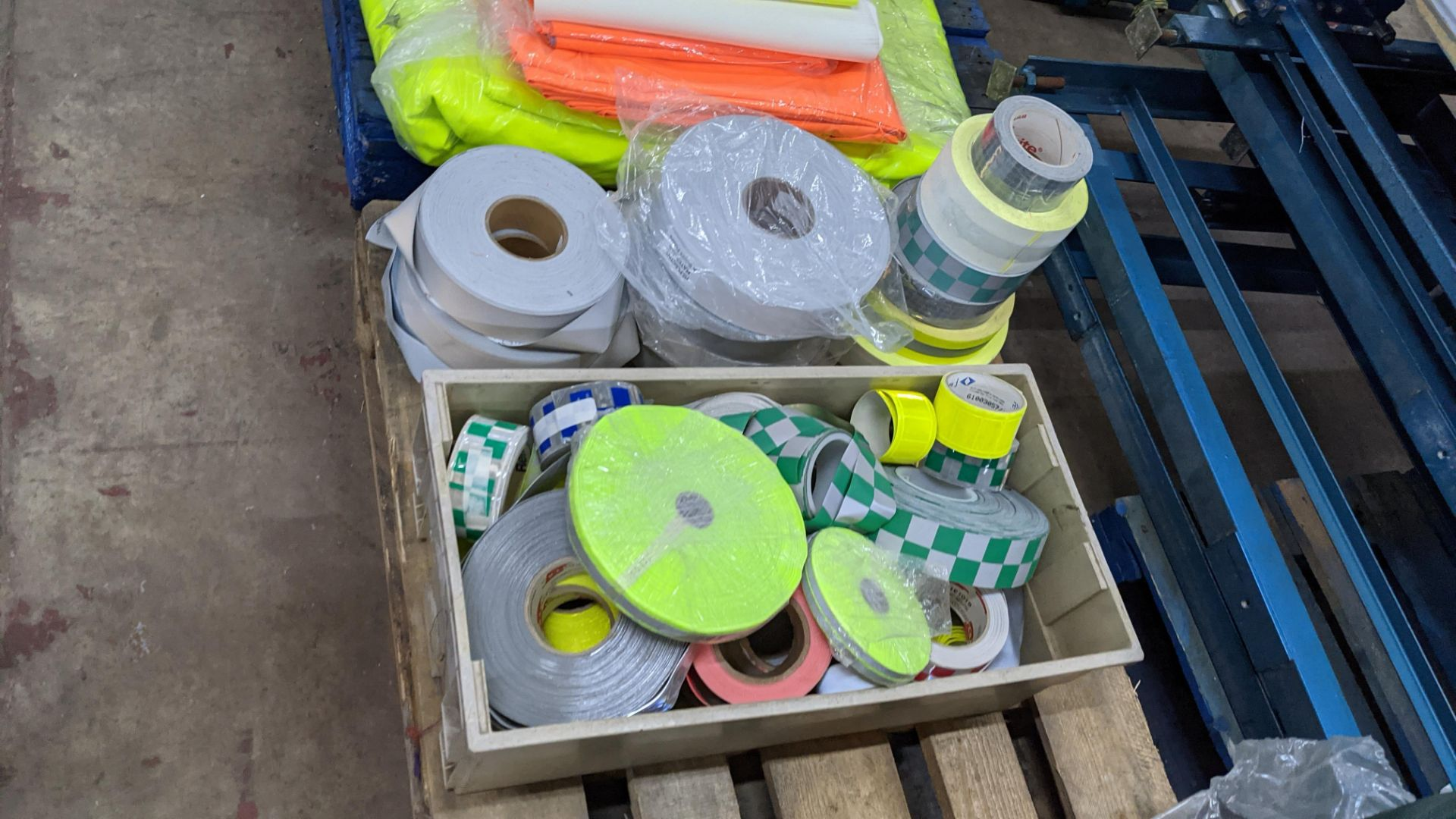 Quantity of hi-vis & reflective fabric & trim comprising 1 stack of fabric, 1 row of reels & the con - Image 9 of 9