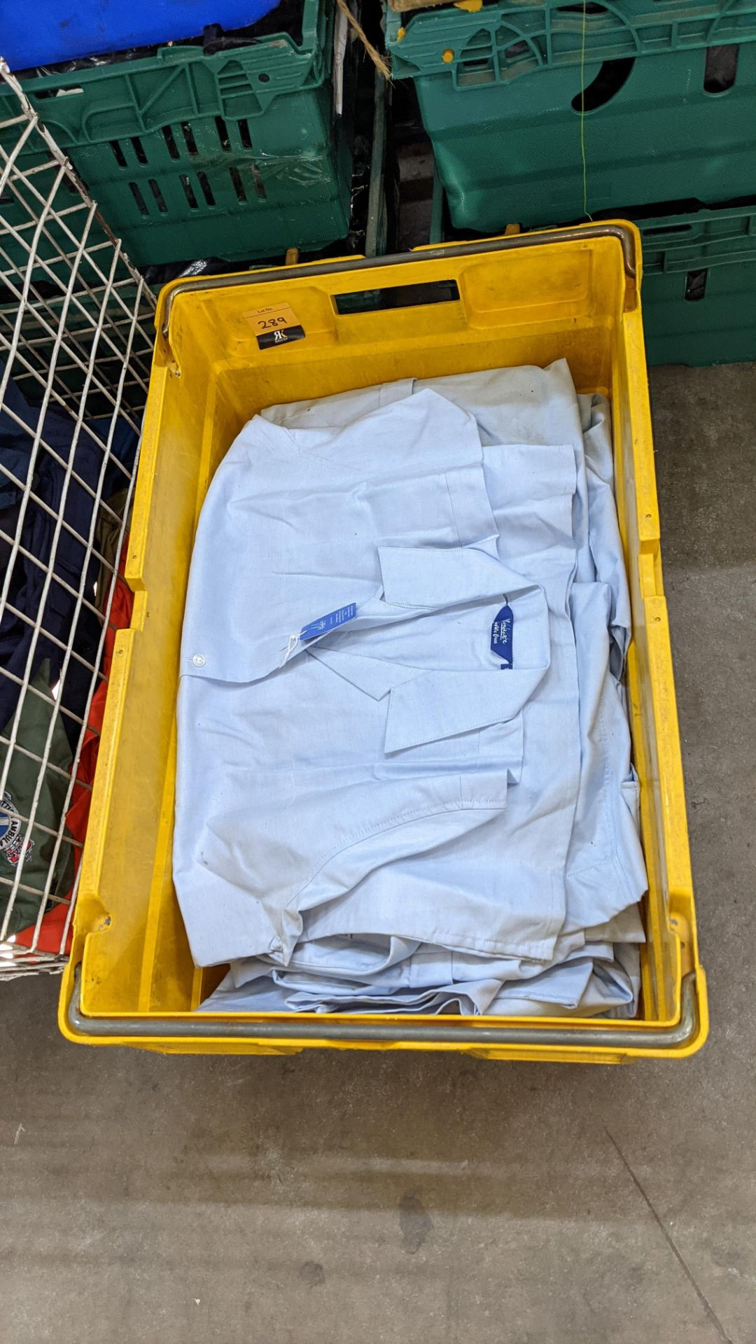 The contents of a crate of sky blue tops. NB crate excluded