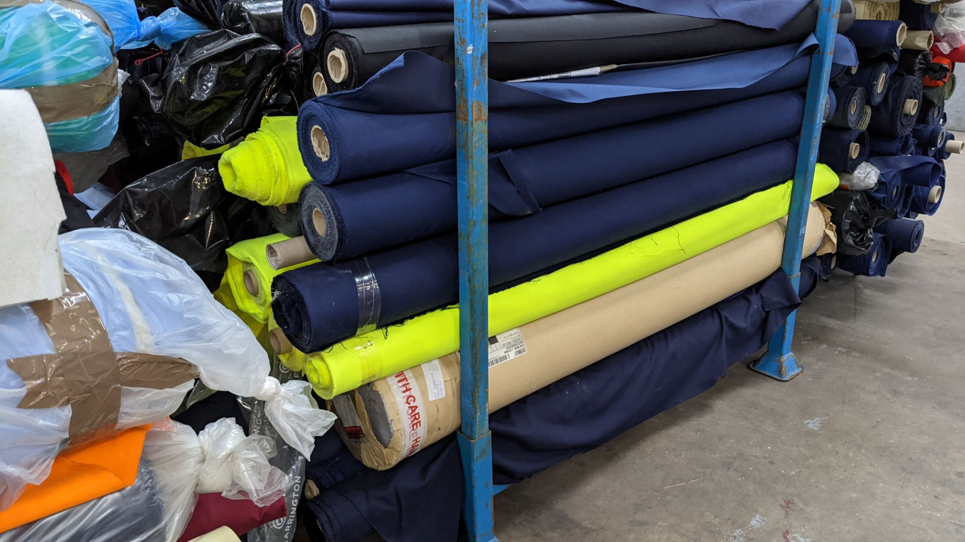The contents of a large stillage of fabric including quantity of high visibility cloth. Please note - Image 3 of 8