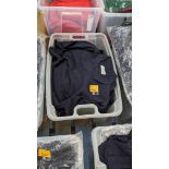 The contents of a crate of navy polo shirts. NB crate excluded