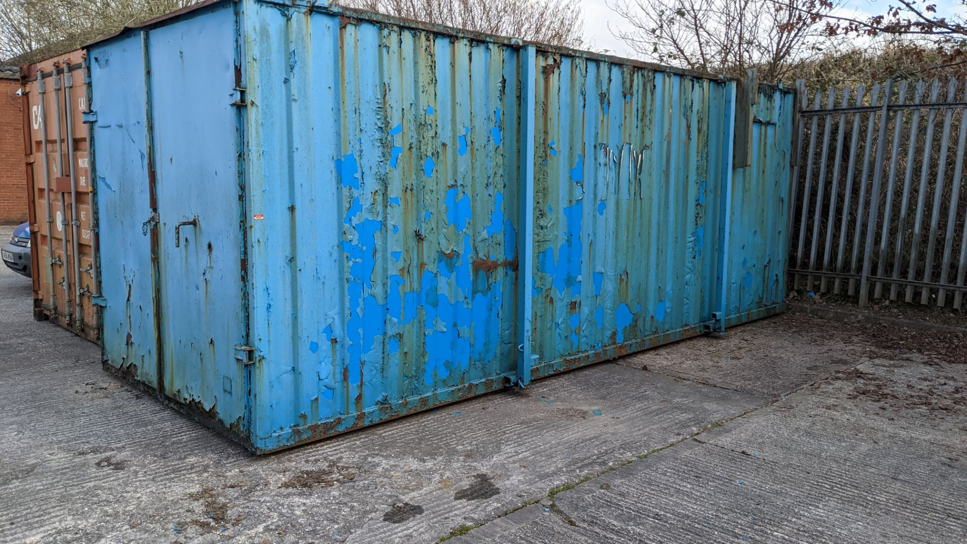 Blue metal container with jack legs & doors at one end. Max external dimensions (excluding legs) ap