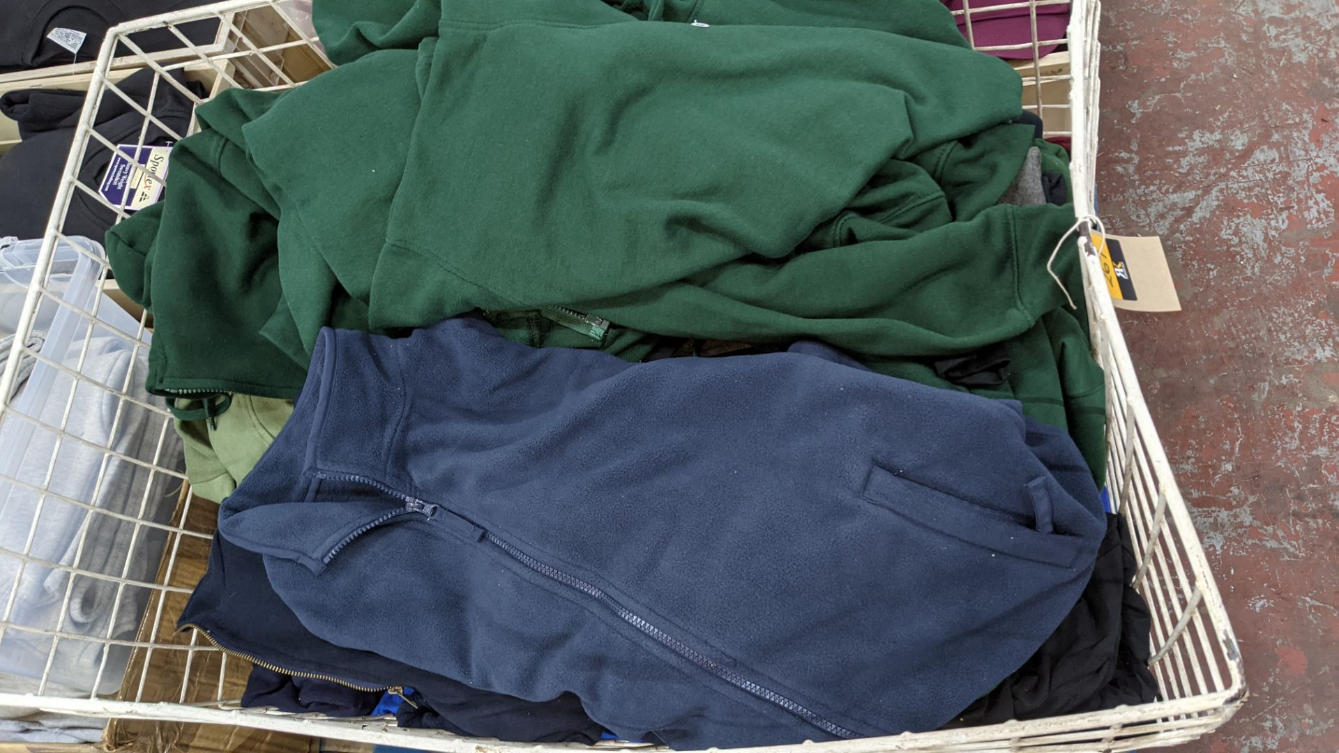 Large quantity of fleece tops - the contents of large cage. NB cage excluded - Image 4 of 8