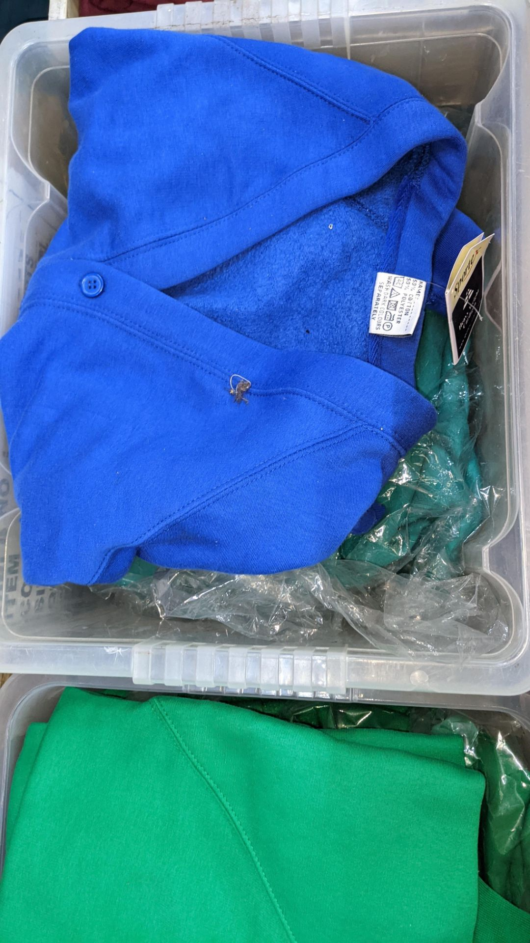 The contents of 2 crates of green & blue button up children's sweat tops & similar. NB crates exclu - Image 4 of 5