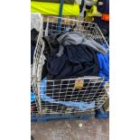 The contents of a cage of assorted adults garments. NB cage excluded
